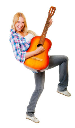 Girl playing the guitar isolated over white Stock Photo - 12274899