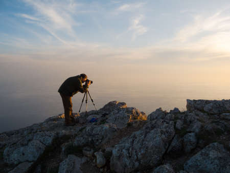 photographing: Photographer take a picture on a nature