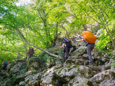 Young people hikes in Crimea mountains photo