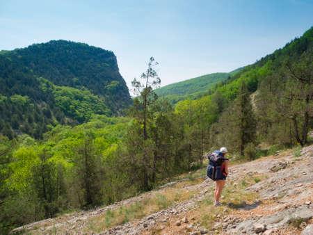 Hiker girl trekking in Crimea mountains photo