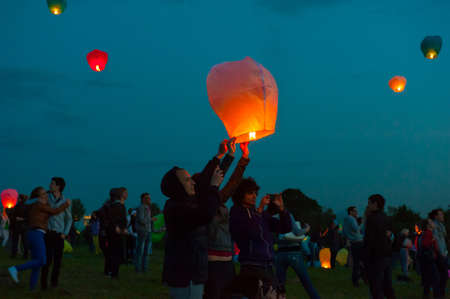 MOSCOW - JUNE 1: Young people release floating lanterns during the First Day of Summer Festival, on June 1, 2012 in Moscow. During the festival flew more than 1,000 lamps.