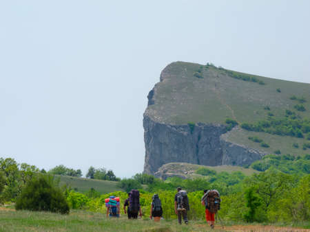 Hikers group walking in Crimea mountains photo