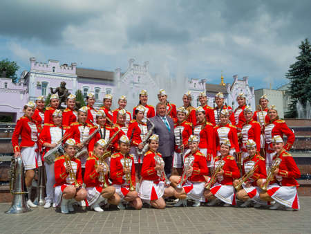 sumy: SUMY - JUNE 28: Female Brass Band posing for a group photo at celebration of the Day of Constitution of Ukraine on June 28, 2012 in Sumy, Ukraine Editorial