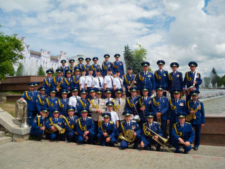 SUMY - JUNE 28: Military brass band posing to photographer at celebration of the Constitution of Ukraine on June 28, 2012 in Sumy, Ukraine