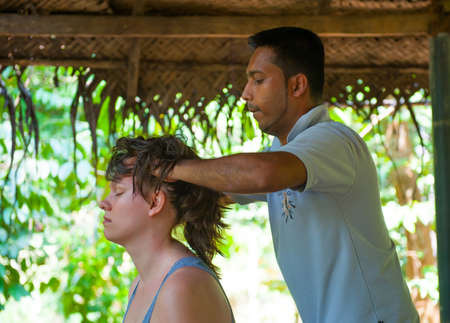 Ayurvedic head massage for a young woman photo