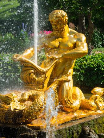 Triton fountain in lower park, Peterhof, Saint Petersburg, Russia photo