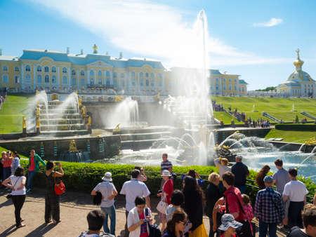ST PETERSBURG - JULY 20: Tourists visit the world famous landmark - Grand cascade in Pertergof on July 20, 2012 in Pertergof, Saint-Petersburg, Russia.