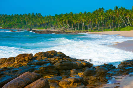 Tropical beach near Tangalle, Sri Lanka. Stones at foreground