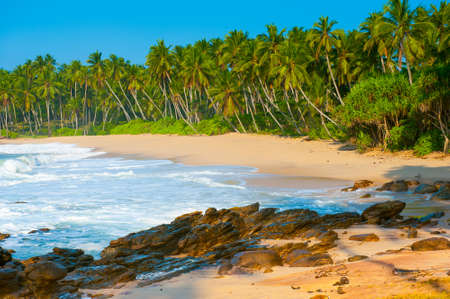 tangalle: Tropical beach near Tangalle, Sri Lanka. Stones at foreground
