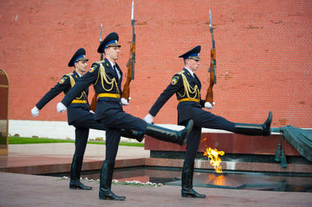 vigilance: MOSCOW - SEPTEMBER 16: Hourly change of the Guard of Honor at the tomb of the Unknown Soldier at the wall of Kremlin on September 16, 2012 in Moscow. Russia.