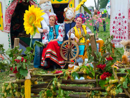 agro: SUMY, UKRAINE - SEPTEMBER 22: Women wearing historical costume posing in traditional village background on annual agro exhibition SUMY-2012 on September 22, 2012 in Sumy, Ukraine