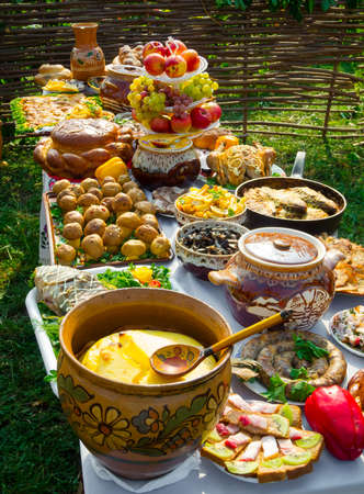 Traditional ukrainian food in assortment in festive decorating on the table photo
