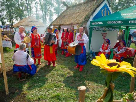 sumy: SUMY, UKRAINE - SEPTEMBER 22  Unidentified folk music band performs in traditional village background at annual agro exhibition SUMY-2012 on September 22, 2012 in Sumy, Ukraine