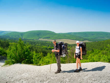 trekker: Hikers couple on a path in Crimea mountains