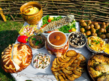 russian culture: Traditional ukrainian food in assortment in festive decorating Stock Photo