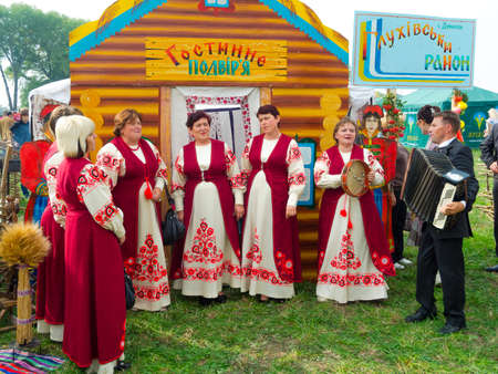 agro: SUMY, UKRAINE - SEPTEMBER 22: Unidentified folk music band performs in traditional village background at annual agro exhibition SUMY-2012 on September 22, 2012 in Sumy, Ukraine