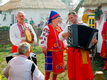sumy: SUMY, UKRAINE - SEPTEMBER 22: Unidentified folk music band performs in traditional village background at annual agro exhibition SUMY-2012 on September 22, 2012 in Sumy, Ukraine