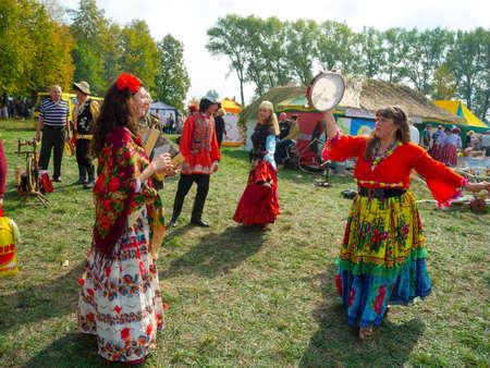 agro: SUMY, UKRAINE - SEPTEMBER 22: Unidentified people wearing historical Gypsy costumes dancing on annual agro exhibition SUMY-2012 on September 22, 2012 in Sumy, Ukraine