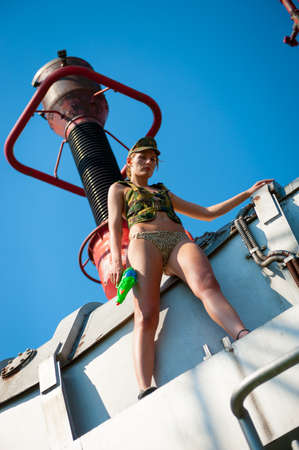 Portrait of young woman in military camouflage on the industrial background Stock Photo - 16250417