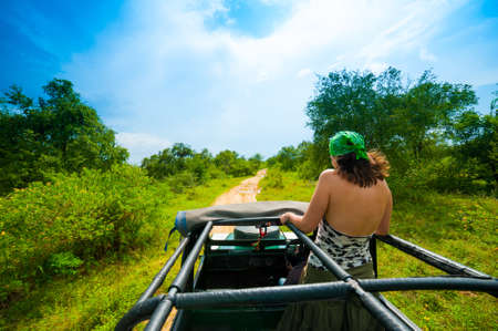Young woman in a safari jeep in Sri Lanka