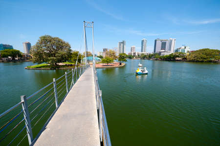 colombo: COLOMBO - APRIL 13: Bridge to Children`s Park in Beira Lake on April 13, 2012 in Colombo, Sri Lanka. Colombo is the largest city and the commercial, industrial and cultural capital of Sri Lanka. Editorial