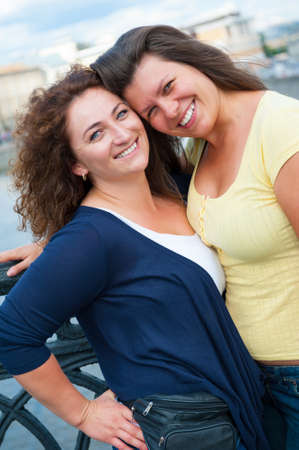 Portrait of two happy young beautiful women photo