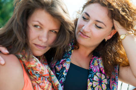 affinity: Portrait of two happy young beautiful women