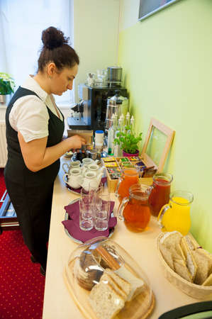Waitress serving breakfast in the hotel photo