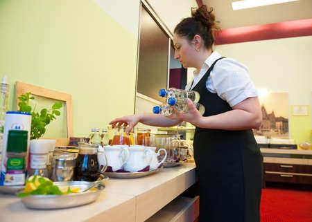 Waitress serving breakfast in the hotel