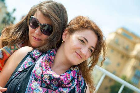lesbian couple: Portrait of two happy young beautiful women