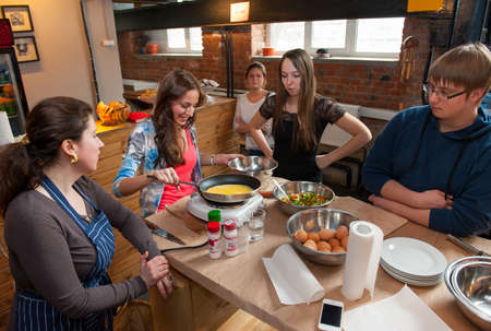 MOSCOW - APRIL 6: Unidentified people learn to cook at cooking class