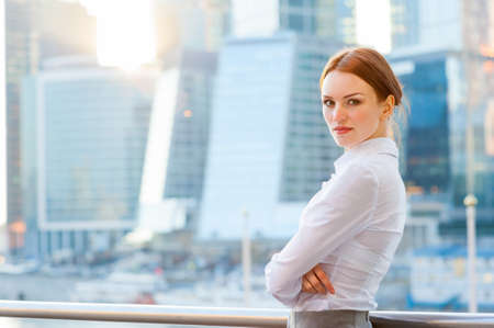 Young business woman on the modern city downtown background Stockfoto