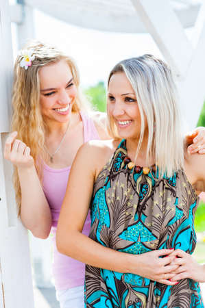 Two young women having fun outdoors photo