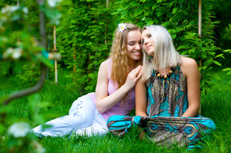 Two young women relaxing in the park photo