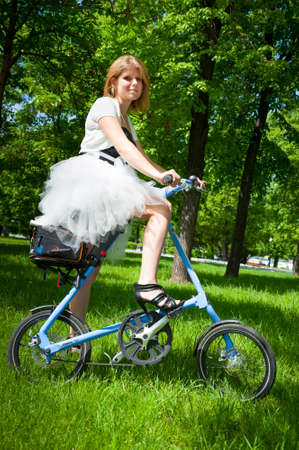 mobs: MOSCOW - MAY 19: Cyclist poses during the Day of the Uniform Bike Action on May 19, 2013 in Moscow. During this event many cyclists ride bicycles in an unusual wear and took part in the flash mobs Editorial