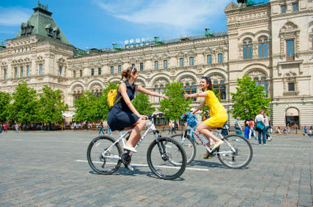 mobs: MOSCOW - MAY 19: Cyclists ride during the Day of the Uniform Bike Action on May 19, 2013 in Moscow. During this event many cyclists ride bicycles in an unusual wear and took part in the flash mobs Editorial