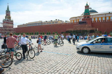 mobs: MOSCOW - MAY 19: Cyclists during the Day of the Uniform Bike Action on May 19, 2013 in Moscow. During this event many cyclists ride bicycles in an unusual wear and took part in the flash mobs
