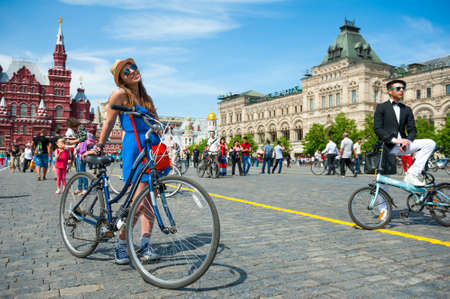 mobs: MOSCOW - MAY 19: Cyclists pose during the Day of the Uniform Bike Action on May 19, 2013 in Moscow. During this event many cyclists ride bicycles in an unusual wear and took part in the flash mobs