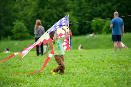 MOSCOW - MAY 25: Unidentified child flies kite at the kite festival in the park Tsaritsyno on May 25, 2013 in Moscow.
