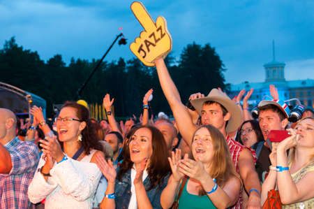"""MOSCOW - JUNE 16: People cheering at open-air concert on X International Jazz Festival """"Usadba Jazz"""" in Archangelskoye Museum-Mansion on June 16, 2013 in Moscow"""