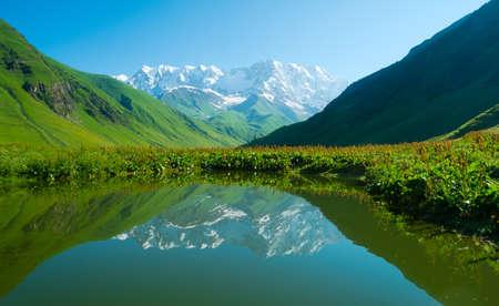 ushguli: Alpine lake near Ushguli, Svaneti, Georgia. Shkhara mountain in the background