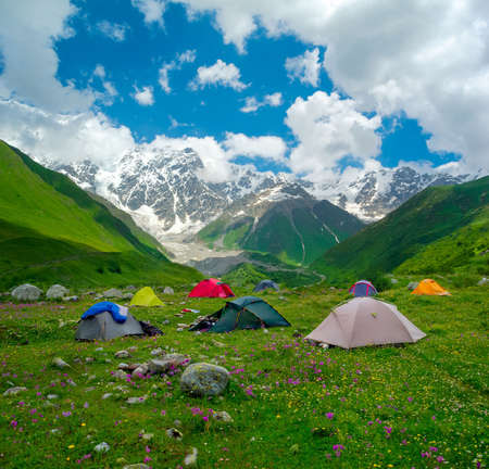 Hikers camp near Ushguli, Svaneti, Georgia. Shkhara mountain in the background Stock Photo