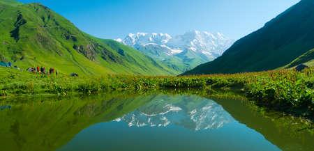 ushguli: Hikers camp near Ushguli, Svaneti, Georgia. Shkhara mountain in the background Stock Photo