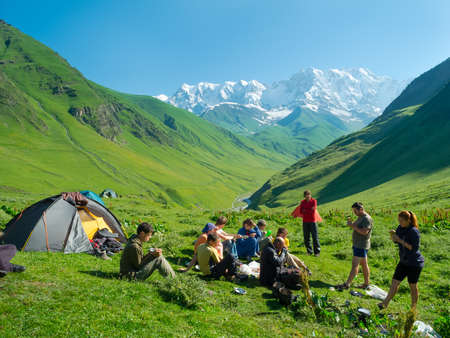 svaneti: Hikers eat breakfast at the camp in the mountains, Svaneti, Georgia