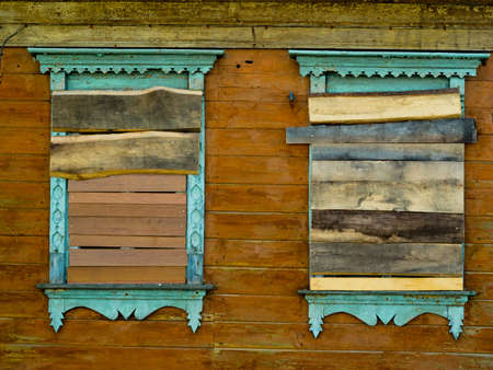 boarded: Boarded windows an old wooden house in Russia