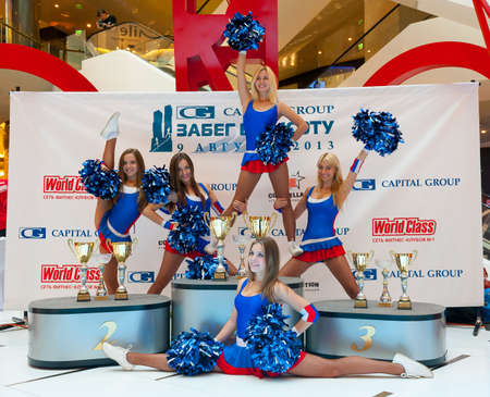 MOSCOW - AUGUST 09: Cheerleaders perform on the event Race to the heighton August 09, 2013, in Moscow City. Runners will race on the roof of a skyscraper by stairs to a height of 76 floor.