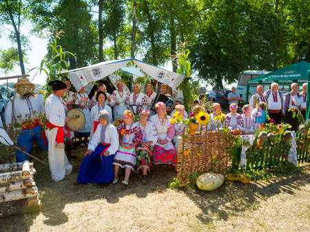 agro: SUMY, UKRAINE - AUGUST 17: Women wearing historical costume posing in traditional village background on annual agro exhibition SUMY-2013 on August 17, 2013 in Sumy, Ukraine