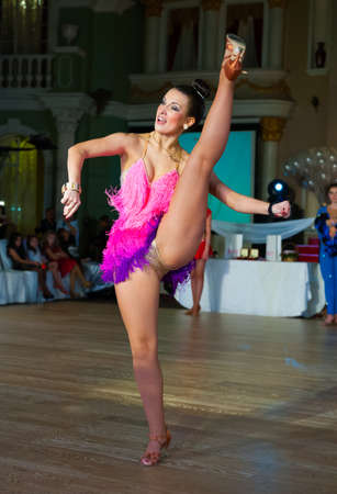 Female dancer performs at dance championship photo