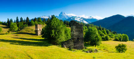 Ushba Peaks landscape, Svaneti, Georgia. Partially destroyed towers in the foreground photo