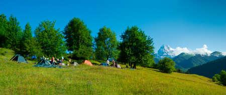 ushguli: Hikers camp near Ushguli, Svaneti, Georgia. Ushba mountain in the background Stock Photo